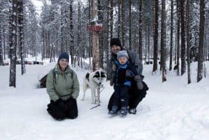 Family with a husky dog at Lapland Safaris