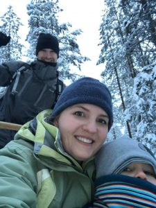 Family riding a dog sled ride
