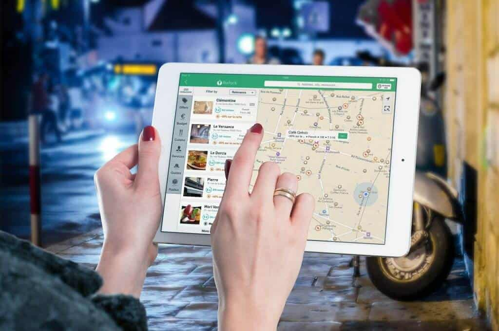 Woman using a map application on a tablet