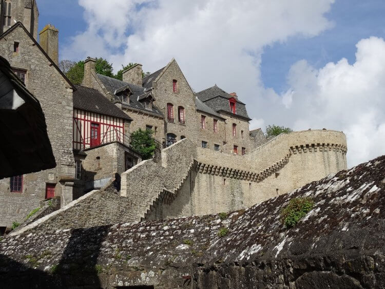 Interior view of Mont Saint Michel looking up the hill to the stairs and buildings.