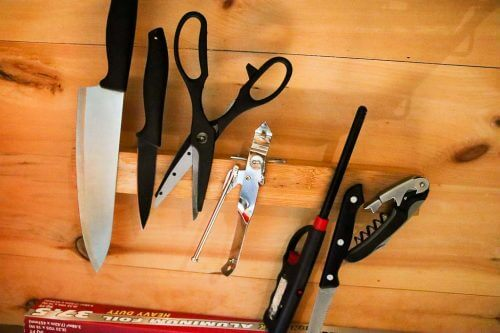 Utensils, Fire starter and cooking knives inside the tiny cabin at the Getaway House DC