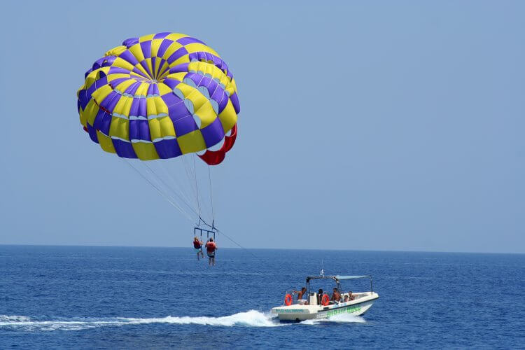 Looking for a high flying adventure? See why you should book with Aguas Azules for the perfect Costa Rica parasailing adventure flying 600 feet over Manuel Antonio National Park. It is one of the recommended adventure trips Costa Rica.