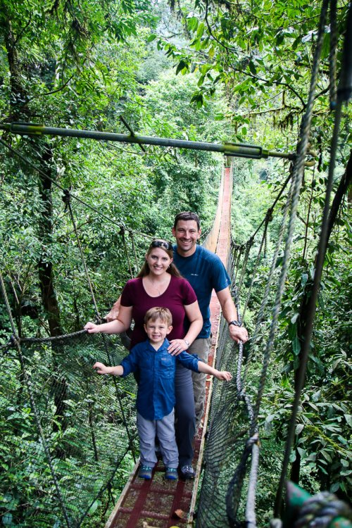 Family taking a photo on the hanging bridge in Rainmaker Park Costa Rica.