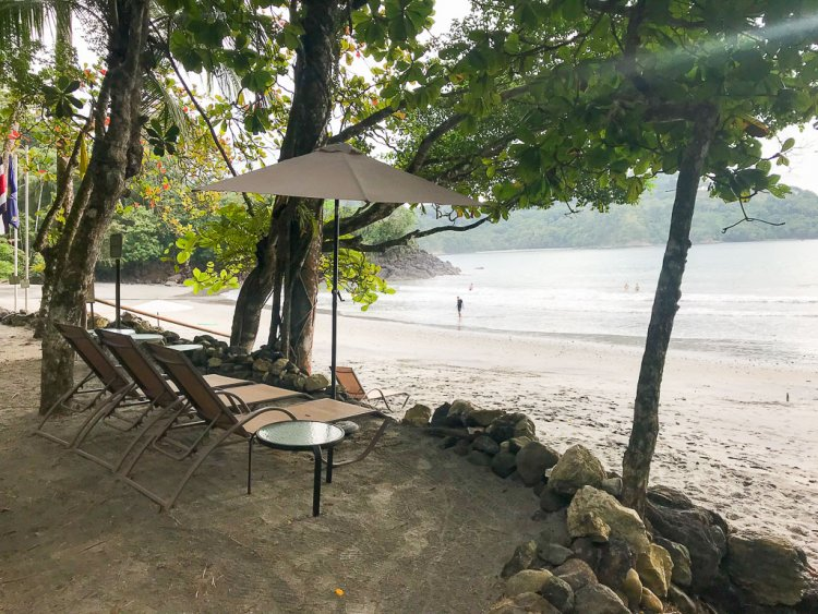 Not sure what to do in Manuel Antonio CR? Book a stay at a resort to enjoy the private beaches. View of lounge chairs overlooking sandy beaches and the ocean.