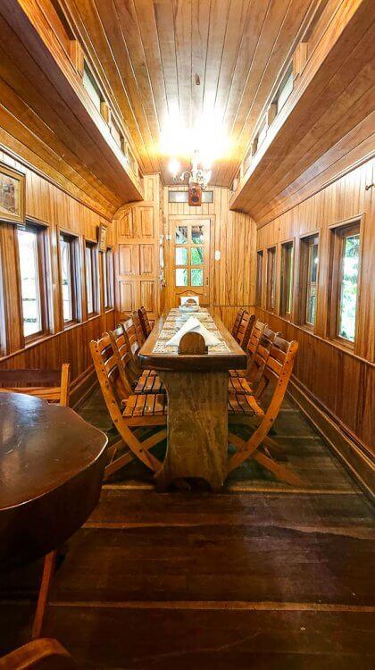 19th Century train car with wood interior and air conditioning at El Wagon in Manuel Antonio.