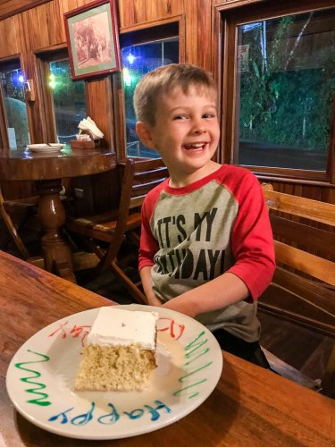 Celebrating our son's birthday with tres leches cake at El Wagon in Manuel Antonio.