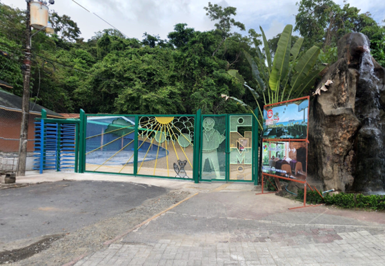 Entrance to Manuel Antonio National Park. Large metal gates.