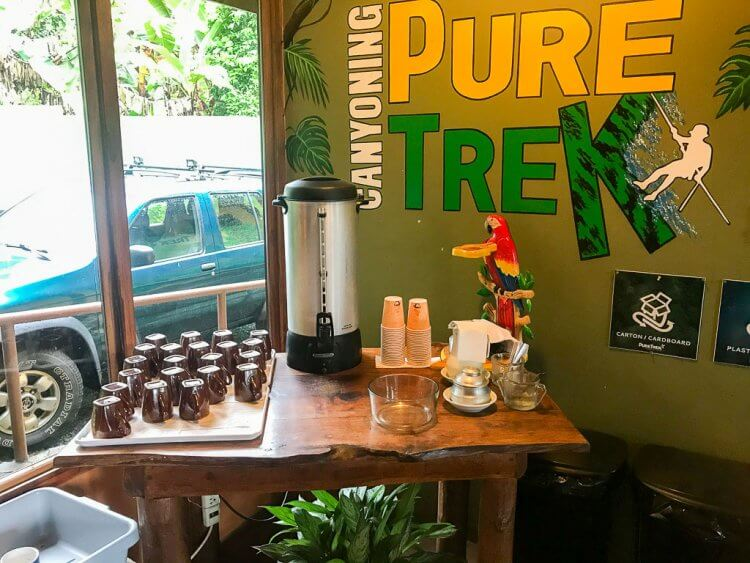 Inside the Pure Trek Canyoning office with free coffee, water and cookies.