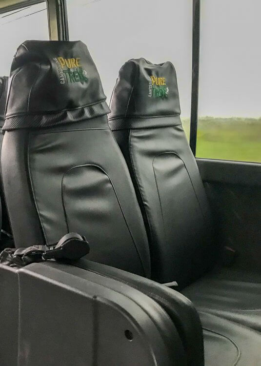 Leather seats inside the Pure Trek Canyoning bus in Costa Rica.