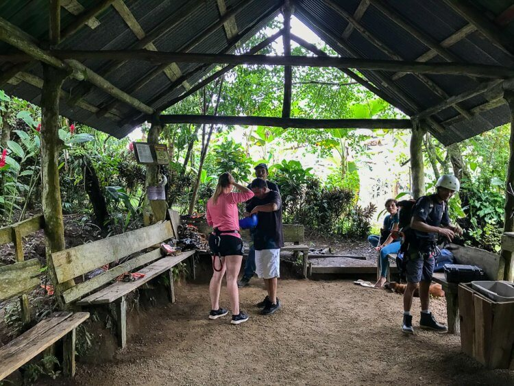 Large covered area where the guests put on the harnesses and helmets before going canyoning in Costa Rica.