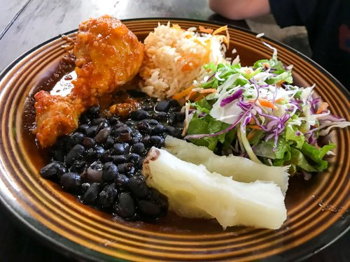 Lunch is served: beans, salad, chicken and cole slaw after your Arenal waterfall rappelling adventure.