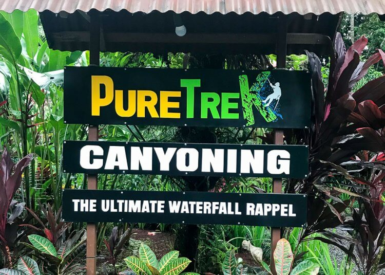 Sign that reads: Pure Trek Canyoning Arenal, Costa Rica.