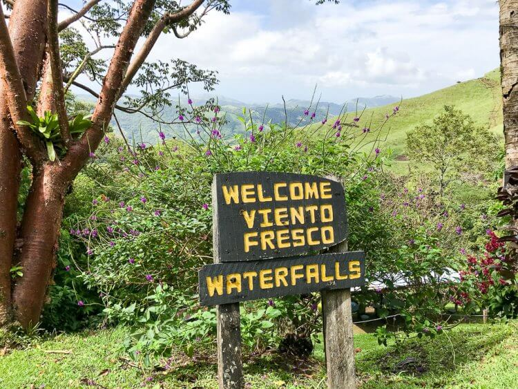 Sign that reads Viento Fresco Waterfalls at the start of the trail.