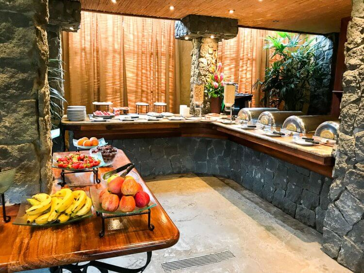 Breakfast Buffet set up with fresh fruits, hot items, yogurt and cereal at the Peace Lodge restaurant.