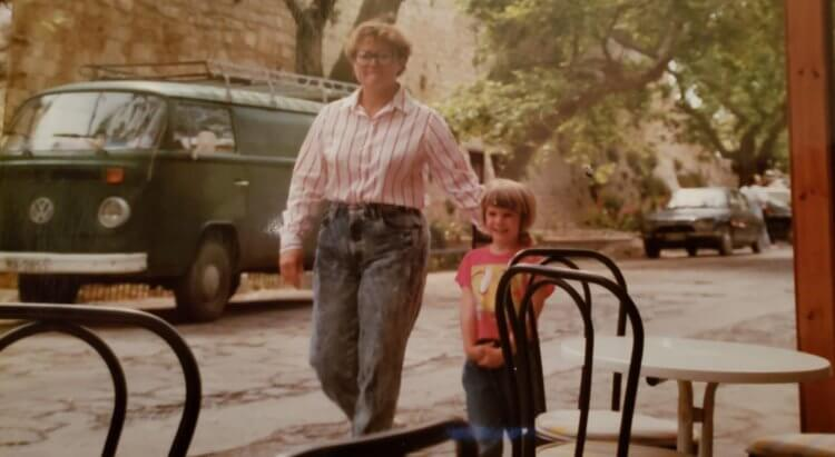 An old photo from the 1980's with a mom and her daughter walking in Greece.