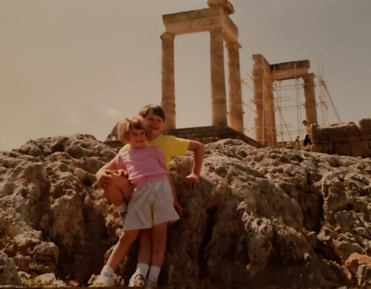An old photo of a little girl and her brother in Athens, Greece