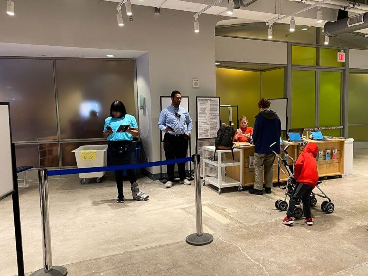 National Children's Museum DC entrance with staff to check tickets, tablets to complete waivers and bag check.