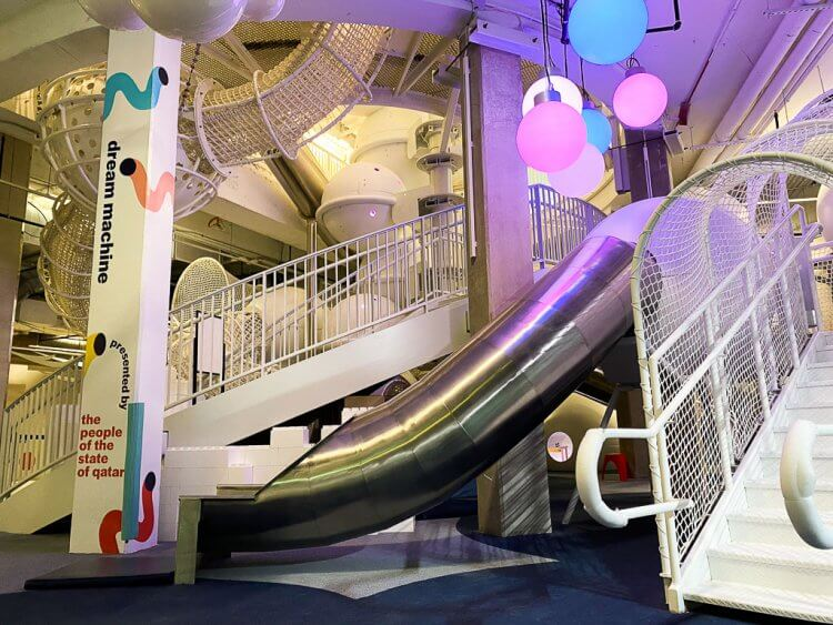 Dream Machine: A large climbing exhibit with slide, stairs, domes, and white net climbs at the National Children's Museum DC