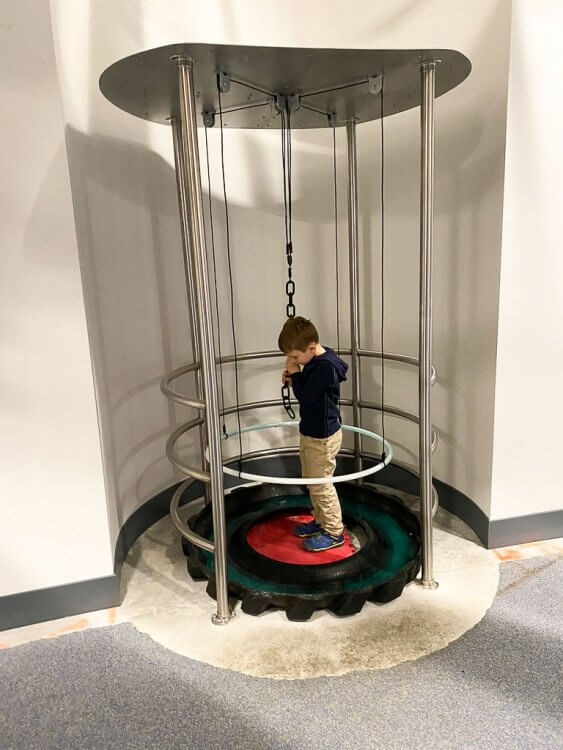 Exhibit where a child can pull a chain and a bubble with surround them.