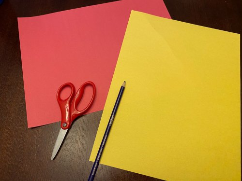 Supplies to make the China Flag: one red and one yellow piece of construction paper with scissors and a black colored pencil.
