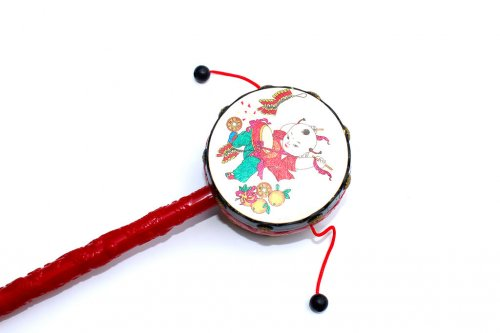 Chinese drum with chinese characters on the front.