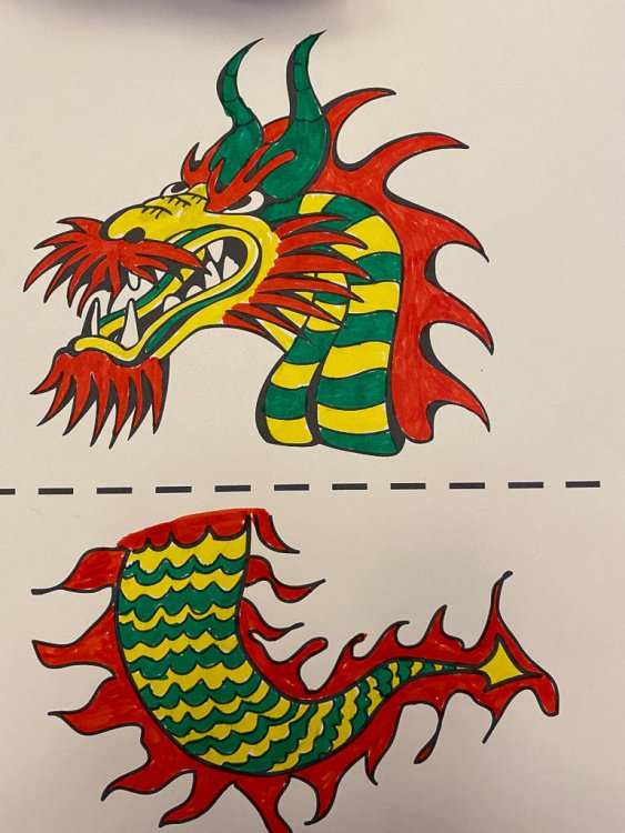 Coloring page with the head of a dragon and a tail of the dragon colored with marker.