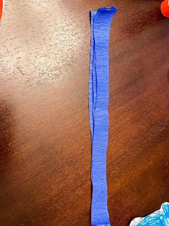 Stacking three pieces of blue crepe paper.