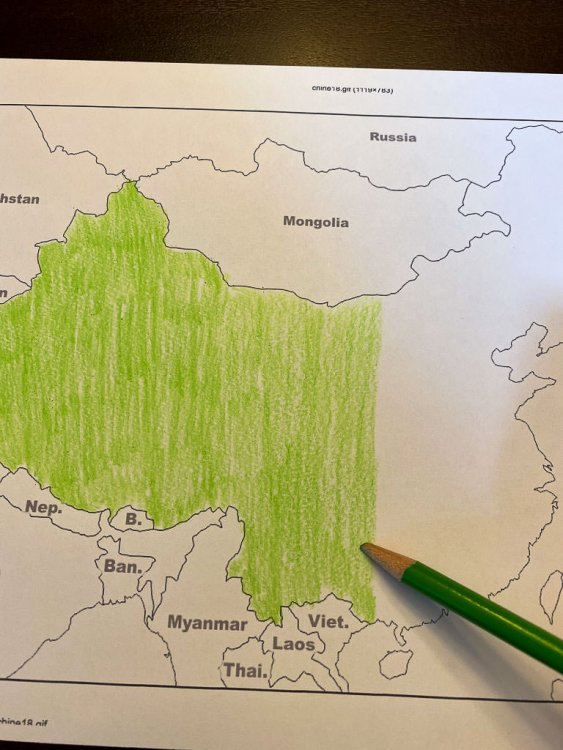 Coloring a map of China. China is being colored Green.