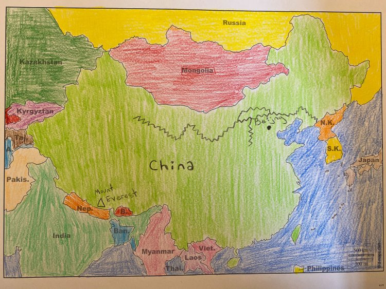 Finished map of China with all the countries colored with colored pencil.