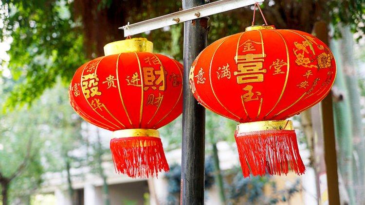 Two Chinese paper lanterns. Paper lantern making.