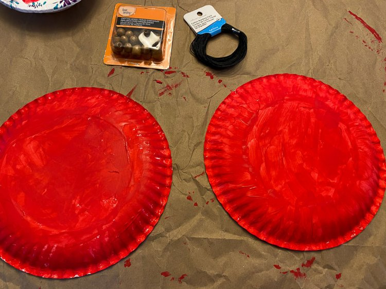 Two paper plates upside down painted red.