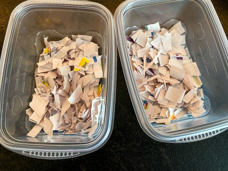 Small bits of newspaper inside the containers.