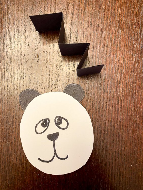 Panda head with accordion style paper.