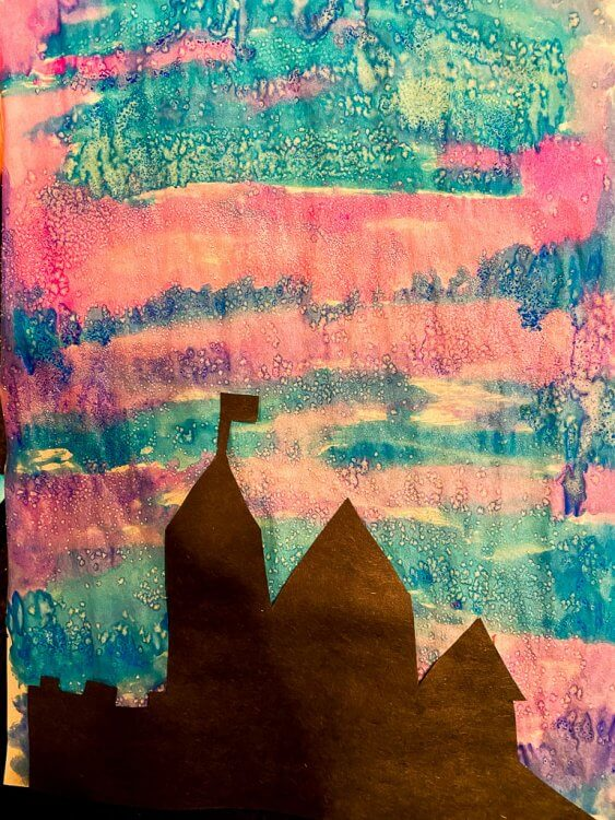 Watercolor painting with silhouette of a castle.
