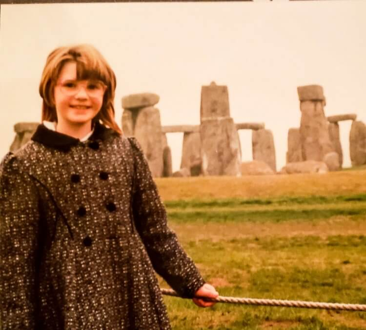 Vintage photo of a little girl in front of Stonehenge
