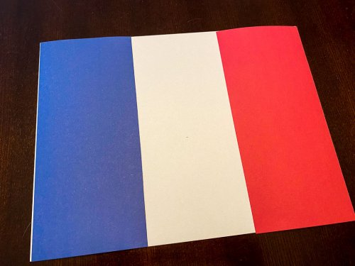 A French flag made out of construction paper.
