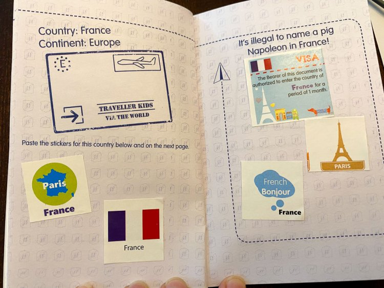 Kids play passport with stickers about France.