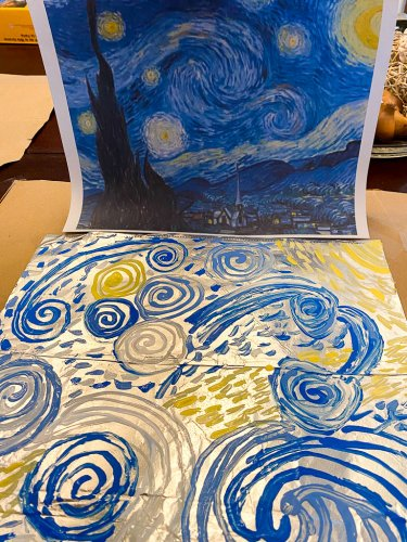 Final painting on foil with blue, light blue, white and yellow swirls to do something similar to Van Gogh's painting.
