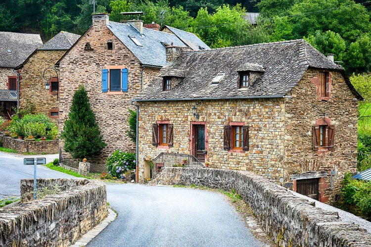 French countryside with old stone buildings and bridges.