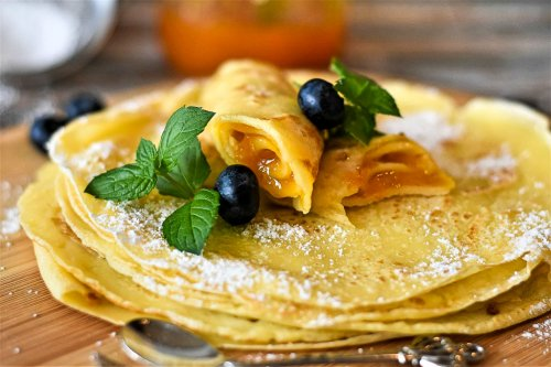Stacked crepes with fresh fruit and mint.