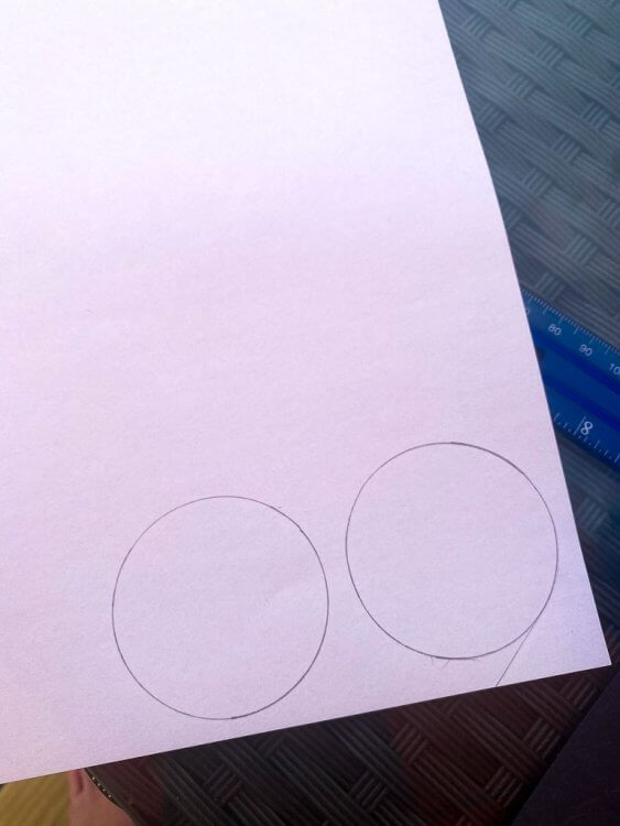 White circle shapes on white paper, ready to be cut.