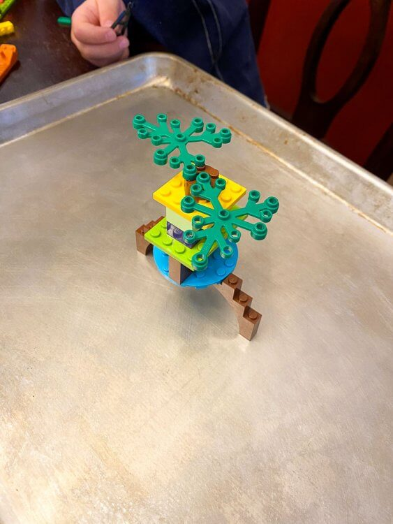A lego creation sitting on the cookie tray.