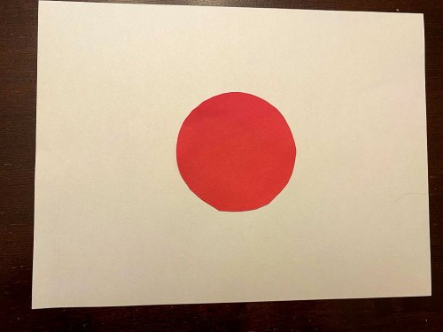 Japan flag craft with a red circle with white background.