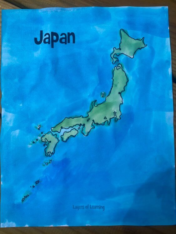 Finished map of Japan with a green color on the country and a blue background.