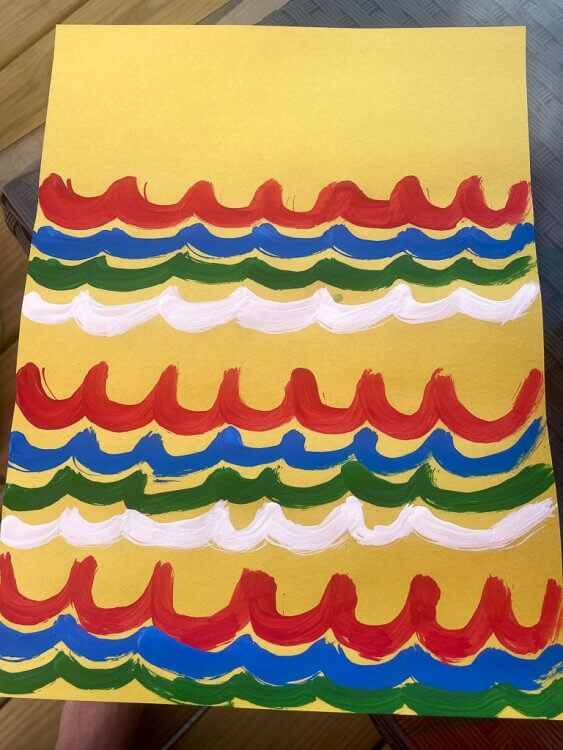 Wave colors on yellow construction paper for Japanese fish kites.