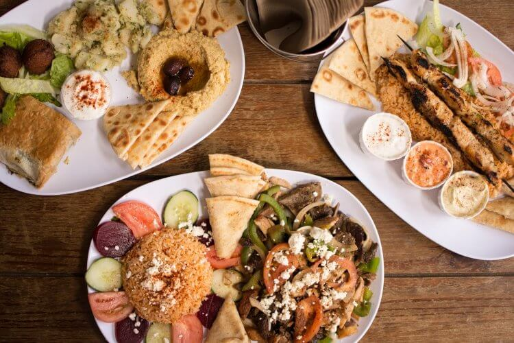 Various Greek Dishes on three plates.