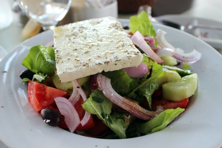 Greek Salad with a large block of Feta.