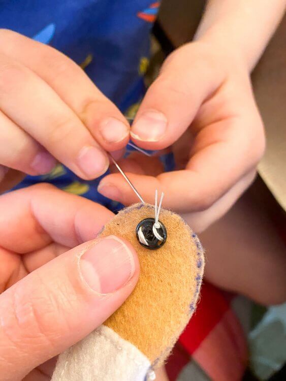 Sewing snaps onto the band aids to make them work.