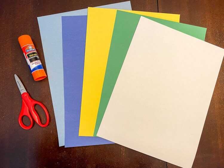 Construction paper: white, green, yellow, dark blue and light blue. Glue and scissors.
