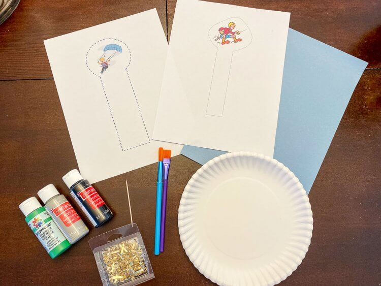 Apline craft with paper plate, paint, paint brush, brads, copies of printed alpine climber and light blue construction paper.